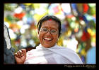 Happy Woman in Kathmandu with prayer flags