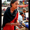 Photo of Nepali girl selling stuff at Kathmandu market on ExposedPlanet.com